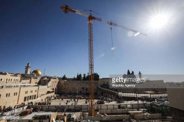 Israeli workers conduct an excavation work around the AlAqsa Mosque in Jerusalem on February 28 2018