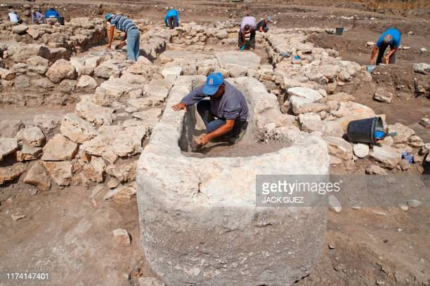 Israeli workers unearth stone structures including a basin believed to be proof of sacrificial offerings at the archaeological site of En Esur where...