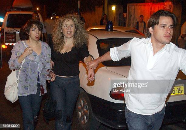 Israeli Wounded are evacuated from the Moment Cafe in Jerusalem Saturday March 09 2002. 11 Israelis were killed after a suicide bomber exploded at a...