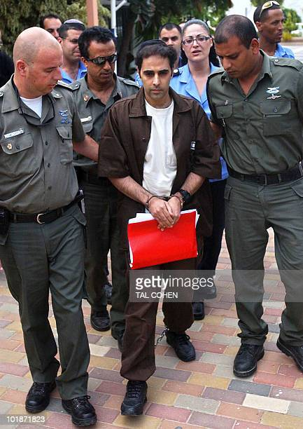 Israeli Yigal Amir assassin of former Israeli Prime Minister Yitzhak Rabin is led by security men into the courtroom prior to his hearing in request...