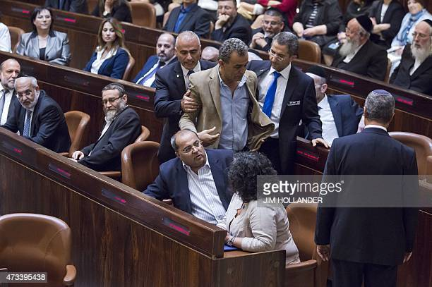 IsraeliArab lawmaker and member of the Joint Arab List Jamal Zahalka is escorted to leave after he reacted to Israeli Prime Minister Benjamin...
