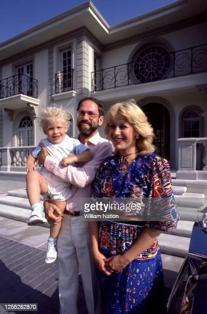Israeli-born American technology entrepreneur, founder and Chief Executive of Monolithic Memories Ze'ev Drori poses for a portrait with his wife, son...