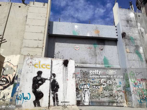 Israelibuilt West Bank Wall surrounding Bethlehem with mural art of Banksy on March 27 2017 in Bethlehem West Bank