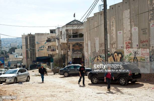 Israelibuilt West Bank Wall surrounding Bethlehem with mural art on March 27 2017 in Bethlehem West Bank