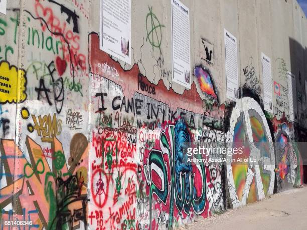 Israelibuilt West Bank Wall surrounding Bethlehem with mural art on March 27 2017 in Bethlehem West Bank