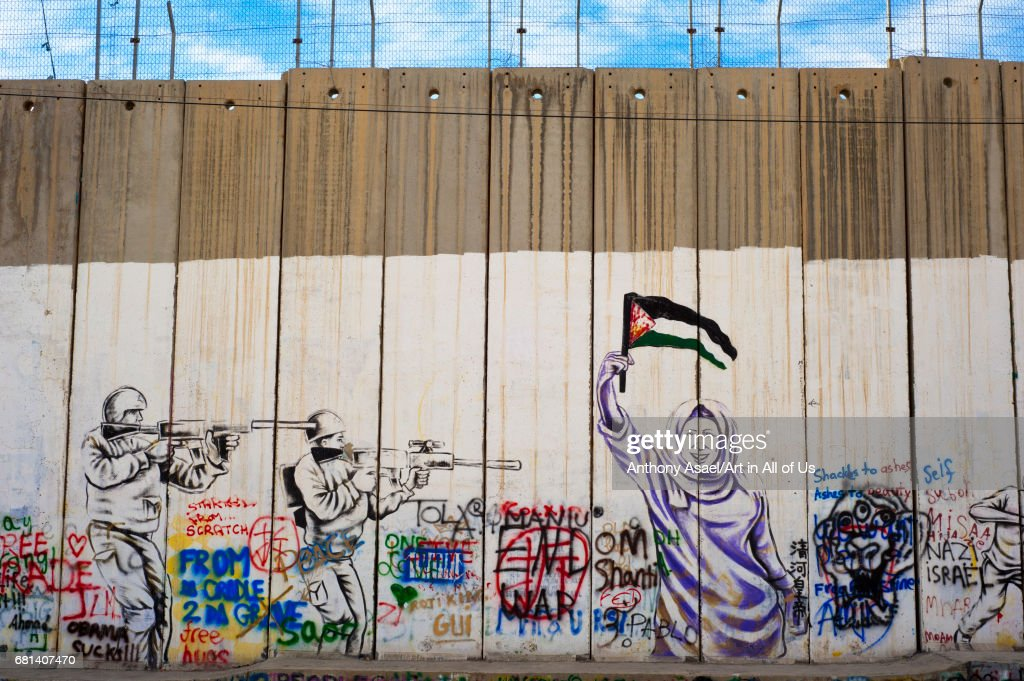 Israeli-built West Bank Wall surrounding Bethlehem with mural art, Bethlehem, West Bank, Israel : News Photo