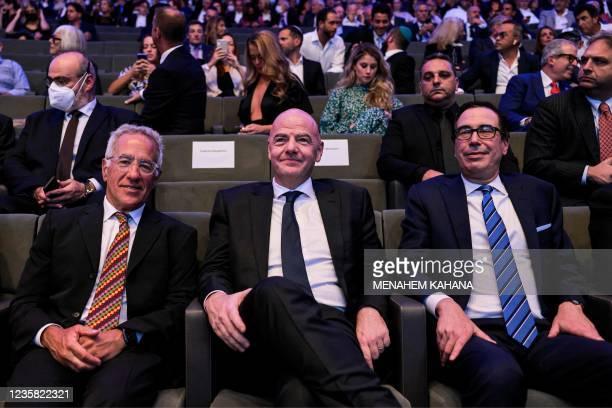Israeli-Canadian billionaire cyclist and businessman Sylvan Adams, FIFA President Gianni Infantino, and former US secretary of the treasury Steve...