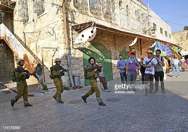 Israeli-Palestinian conflict. Hebron is one of the most disputed cities of the West Bank. Hundreds of Israeli settlers have decided to come and live...