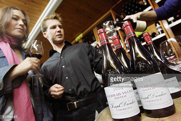 Israelis are seved with French winemaker Joseph Drouhin's Beaujolais Nouveau 2004 at George Hinawi's liquor merchants moments after midnight November...