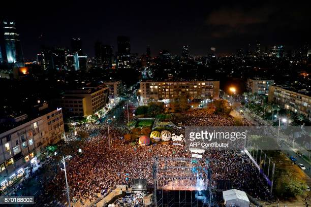 Israelis attend a rally to mark the 22nd anniversary of the assassination of former Israeli prime minister Yitzhak Rabin, on November 4 at Rabin...