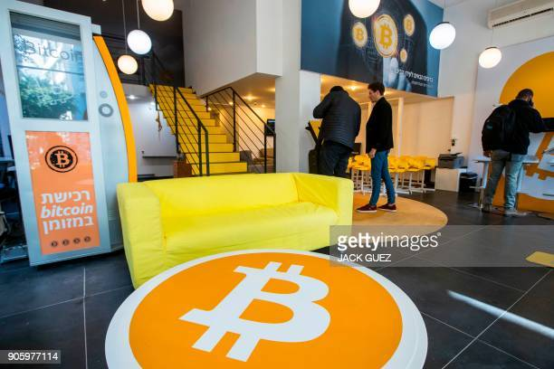 Israelis buy Bitcoins at the cryptocurrency 'Bitcoin Change' shop in the Israeli city of Tel Aviv on January 17 2018 At the end of 2017 Israel...