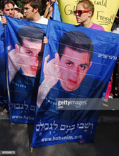 Israelis carrying posters of captured Israeli soldier Gilad Shalit protest in front of the residence of Foreign Minister Tzipi Livni in TelAviv on...