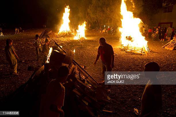 Israelis celebrate with bonfires Lag Baomer in the coastal city of Netanya north of Tel Aviv on May 21 2011 The Lag Baomer bonfire is to commemorate...
