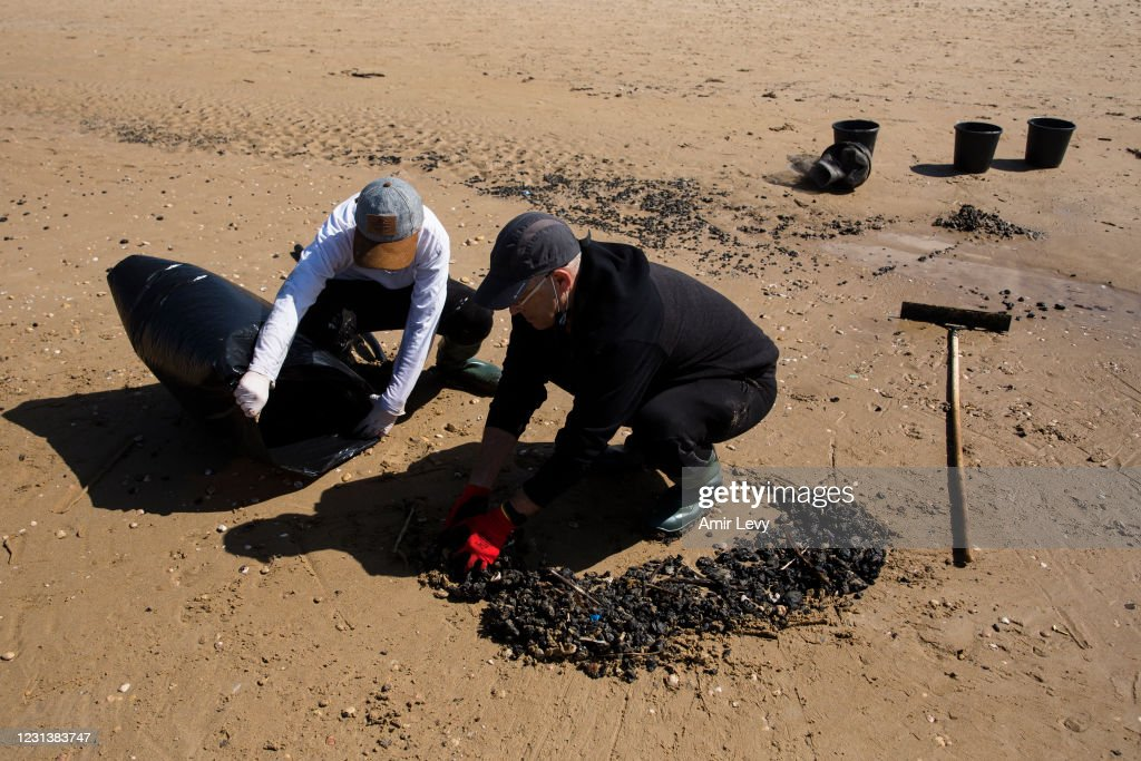 Cleanup Continues After Suspected Oil Spill Off Israel's Coast : News Photo