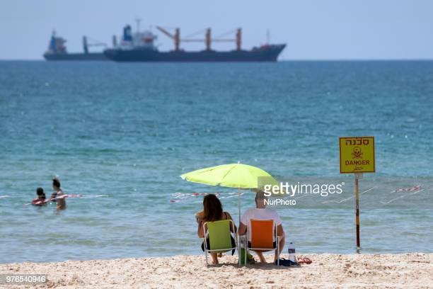Israelis cool off near the beach as a heat wave hits the port town of Ashdod Israel on June 15 2018 Ashdod a popular beach town with the largest port...