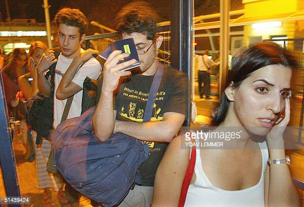 Israelis cross the border into the Israeli town of Eilat from the Egyptian resort of Taba on the Red Sea 08 October 2004 Some 100 people were wounded...