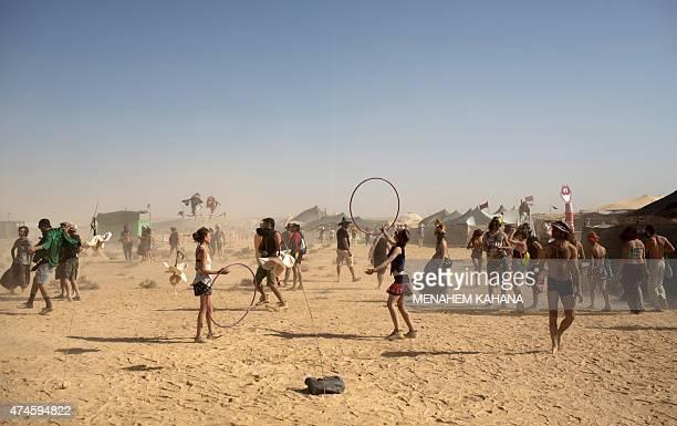 Israelis dance during the 2015 Midburn festival in the Negev Desert near the Israeli kibbutz of Sde Boker on May 21 2015 Some 6000 Israelis and...
