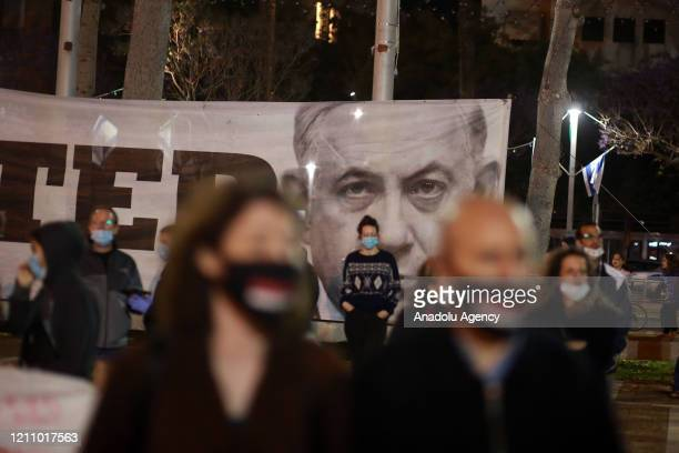 Israelis demonstrate against Prime Minister Benjamin Netanyahu due to his upcoming trial for corruption, keeping two metres apart under coronavirus...