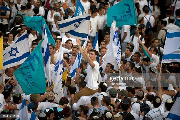 Israelis during a march marking Jerusalem Day on May 28 2014 outside Jerusalem's old city Israel Israel is celebrating the anniversary of the...