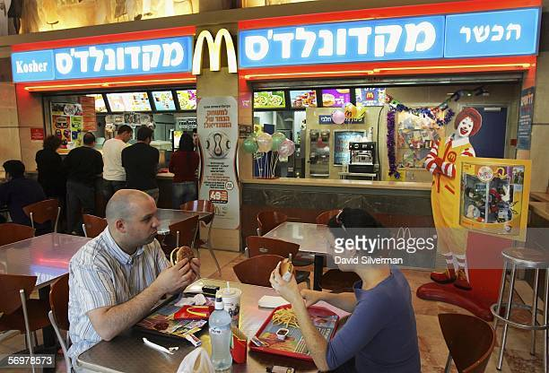 Israelis eat at a kosher McDonald's restaurant March 2 2006 in Tel Aviv After being pressured by Tel Aviv's Chief Rabbi two of the city's McDonald's...
