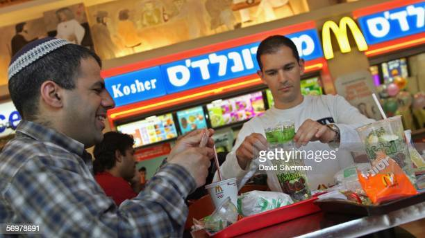 Israelis eat at a kosher McDonald's restaurant March 2 2006 in Tel Aviv This is the first time for the international corporation to give the golden...