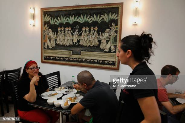 Israelis eat at the Maharaja Indian restaurant in the small city of Ramla south of Tel Aviv on July 2 as the Jewish Indian community in Israel...