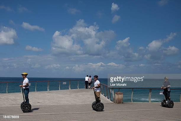 Israelis enjoy a stroll with a Segway on the beach on October 03, 2013 in Jaffa, a suburb of Tel Aviv, Israel.