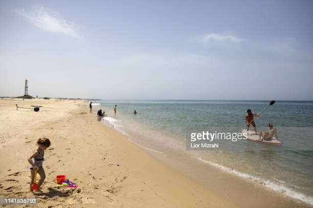 Israelis enjoy the beach near the border with the Gaza Strip on May 6 2019 in Zikim Israel Palestinian leaders in Gaza agreed a ceasefire with Israel...