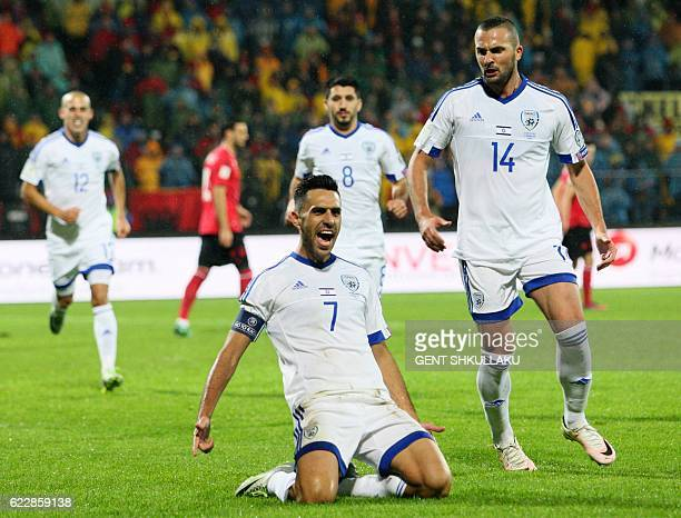 Israeli's Eran Zahavi and Ben Sahar celebrate after scoring a goal during the World Cup 2018 qualifier football match Albania versus Israel at the...