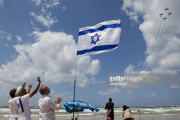 Israelis gather on the beach in the Mediterranean coastal city of Tel Aviv to watch a military air show marking the 65th anniversary of Israel's...