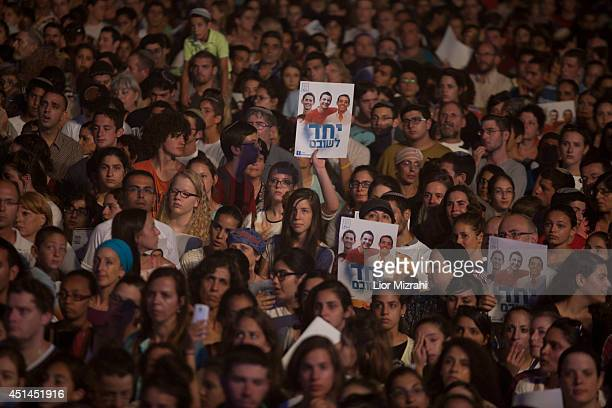 Israelis hold a poster showing the three missing Israeli teenagers as they attend a rally under the slogan 'Bring Our Boys Home' on June 29 2014 in...
