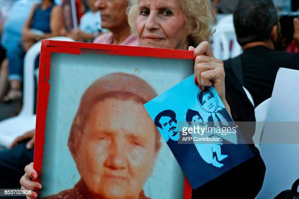 Israelis hold pictures of Yemenite Jews whose children were reportedly abducted in the 1950's during a demonstration in Tel Aviv on September 25...