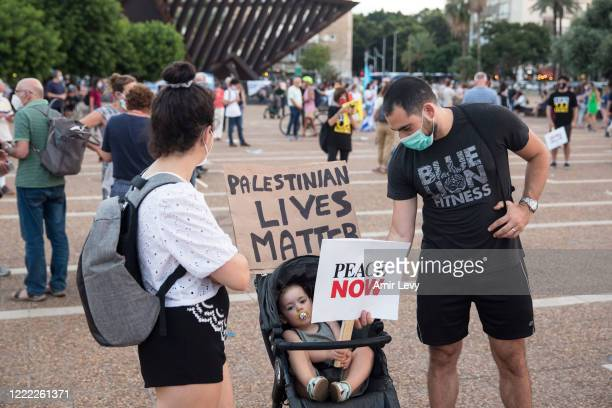 Israelis hold signs as they protest against Israel goverment's plan to annex parts of the West Bank on June 23, 2020 in Tel Aviv, Israel. Defense...