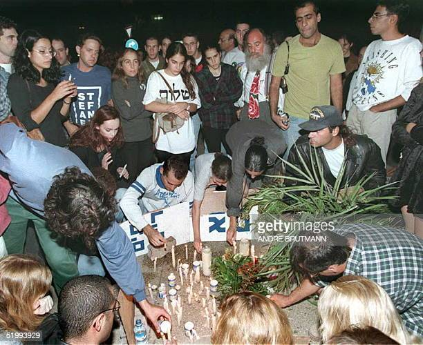 Israelis light candles at the site of the assassination of Israeli Prime Minister Yitzhak Rabin at the end of a rally 'For PeaceAgainst Violence'in...