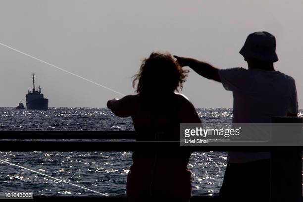 Israelis look at the Rachel Corrie aid ship as it enters the military port of Ashdod in southern Israel after it was intercepted by the Israeli Navy...