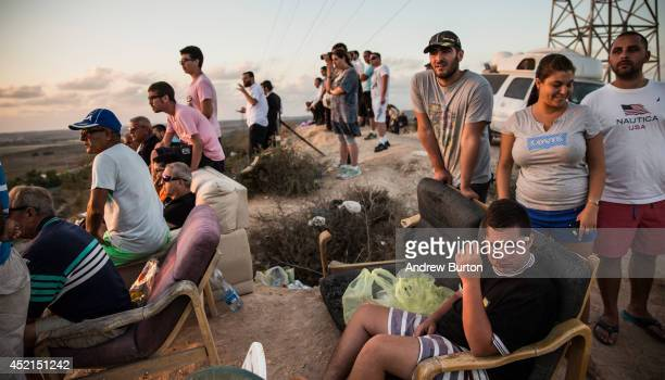 Israelis look for outgoing rocket fire from Gaza and wait for Israeli airstrikes from a hill overlooking the Gaza Strip on July 14, 2014 in Sderot,...