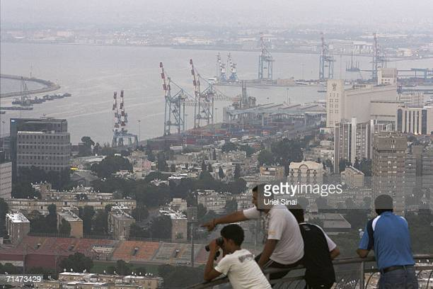 Israelis look skywards for signs of an incoming missile as sirens wail July 18 2006 in the northern Israeli city of Haifa Thirteen Israeli civilians...
