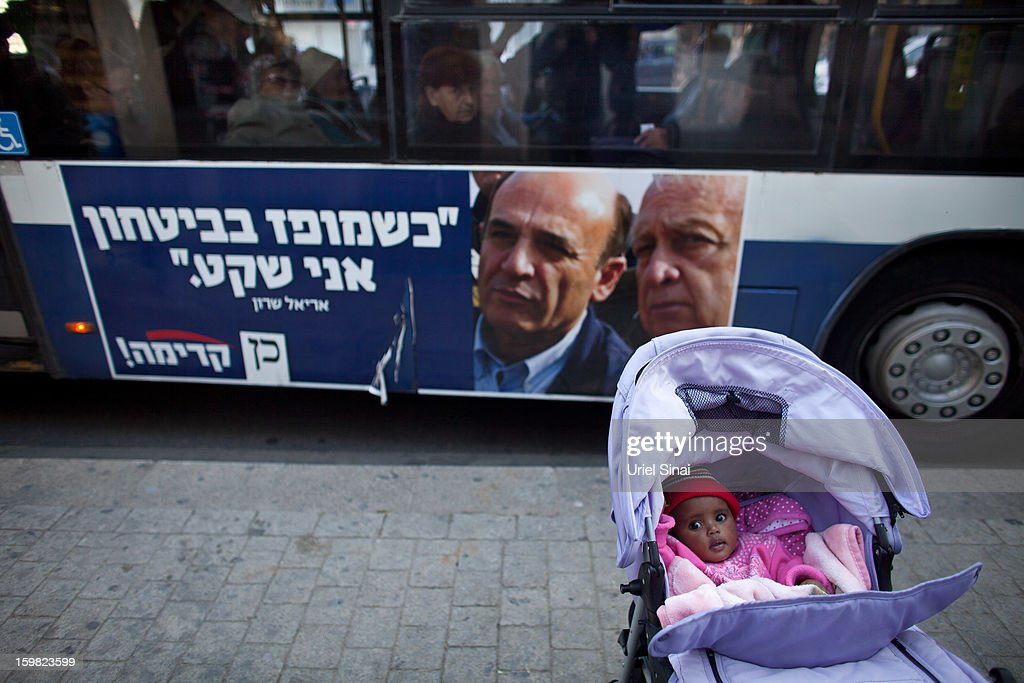 Israelis on board a bus displaying an election poster on its side on January 21, 2013 in Tel Aviv, Israel. Israeli elections are scheduled for January 22 and so far showing a majority for the Israeli right.