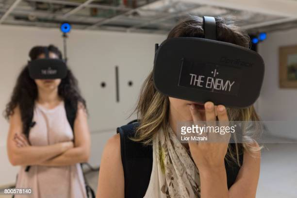 Israelis participant in 'The Enemy' Virtual Reality experience on June 24 2017 in Tel Aviv Israel The Enemy created by Karim Ben Khelifa brings the...