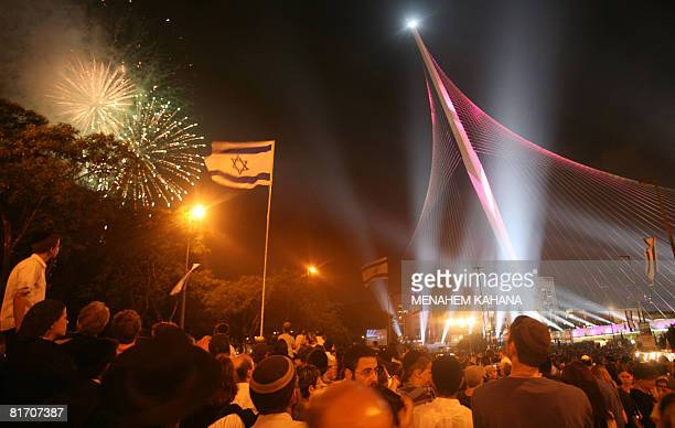 Israelis participate in the inauguration ceremony of the 'Chords Bridge' designed by Spanish architect Santiago Calatrava at the main entrance of...