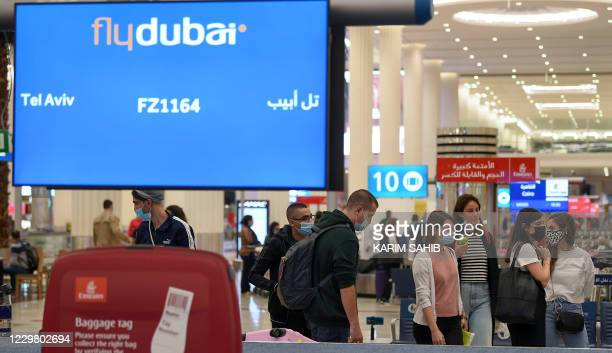 Israelis pick up their luggage upon arrival from Tel Aviv to the Dubai airport in the United Arab Emirates, on November 26 on the first scheduled...