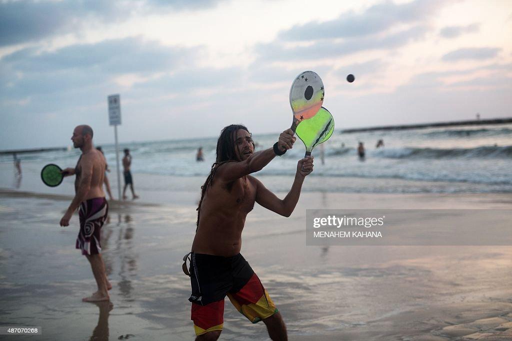 Rousseau israelis play matkot a kind of beach paddleball rousseau israelis play matkot a kind of beach paddleball without rules or publicscrutiny Gallery