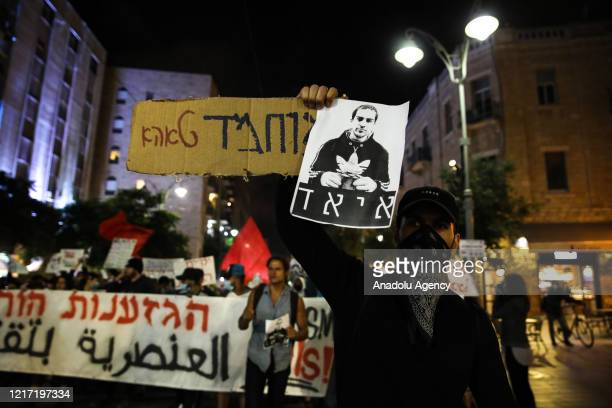 Israelis protest against the shooting dead of Eyad El-Hallaq, a 32-year-old mentally disabled Palestinian, by Israeli forces at Jaffa Street in...