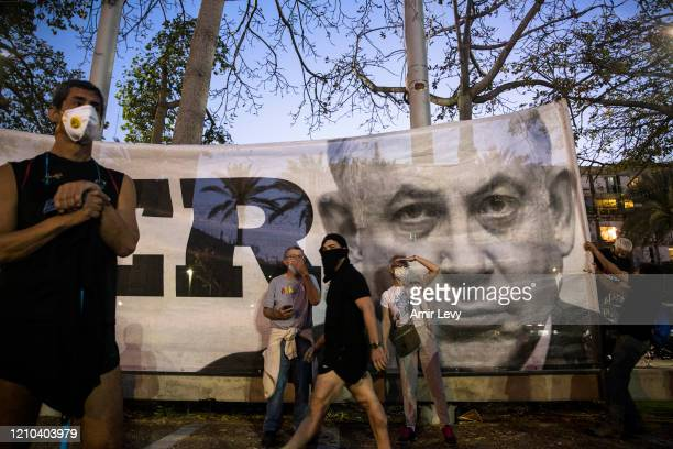 Israelis protest at a rally in Rabin Square on April 19, 2020 in Tel Aviv, Israel. Thousands of Israelis gather at an Anti-Corruption rally under...