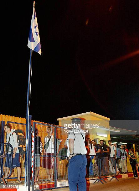 Israelis queue to cross the border into the Israeli town of Eilat from the Egyptian resort of Taba on the Red Sea 08 October 2004 Some 100 people...