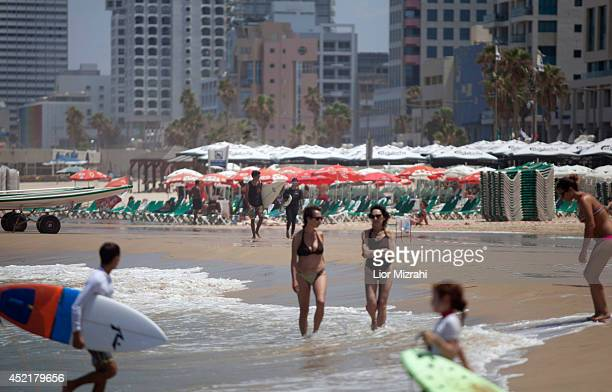 Israeli's relax on the beach on July 15 2014 in Tel Aviv Israel As operation 'Protective Edge' enters it's eighth day of airstrikes by the Israel...