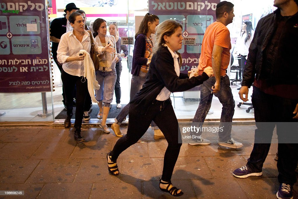 Israelis run for cover during a rocket attack on November 18, 2012 in Tel Aviv, Israel. At least 53 Palestinians and three Israeli's have died since the conflict began five days ago.