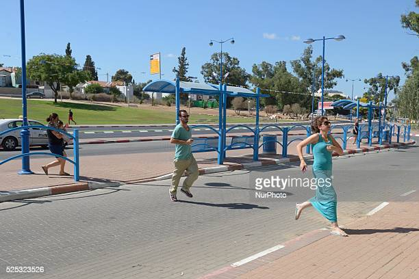 Israelis run to take cover in a shelter as a Red Alert Siren is heard in the Southern city of Sderot on July 17 2014