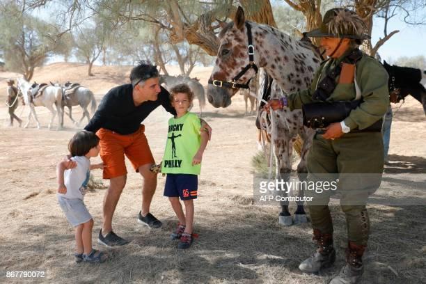 Israelis speak to a member of the Australian Light Horse association on October 29 2017 near BeerSheva on the northern Israeli desert during a...