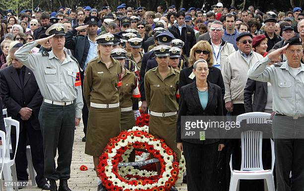 Israelis stand as they mark two-minute silence prior to the wreath laying ceremony at the start of annual Holocaust Martyrs and Heroes Remembrance...